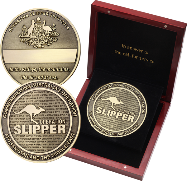 Big brass finish medallion with leaping kangaroo and words Operation Slipper on obverse surrounded by the words